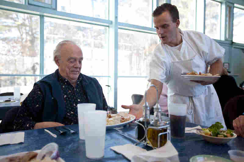 Molina serves lunch to Walt Tetschner of Acton, Mass. The inmates learn a lot of skills on the job, including waiting on tables.