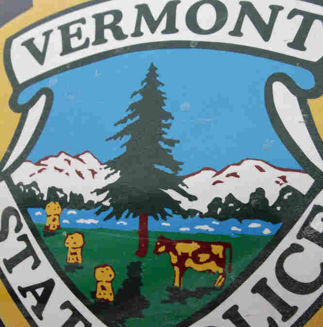 The state seal is seen on the side of a Vermont State Police cruiser. Some Vermont inmates have gotten the best of the state police by adding a pig to the state decal on their cruisers.