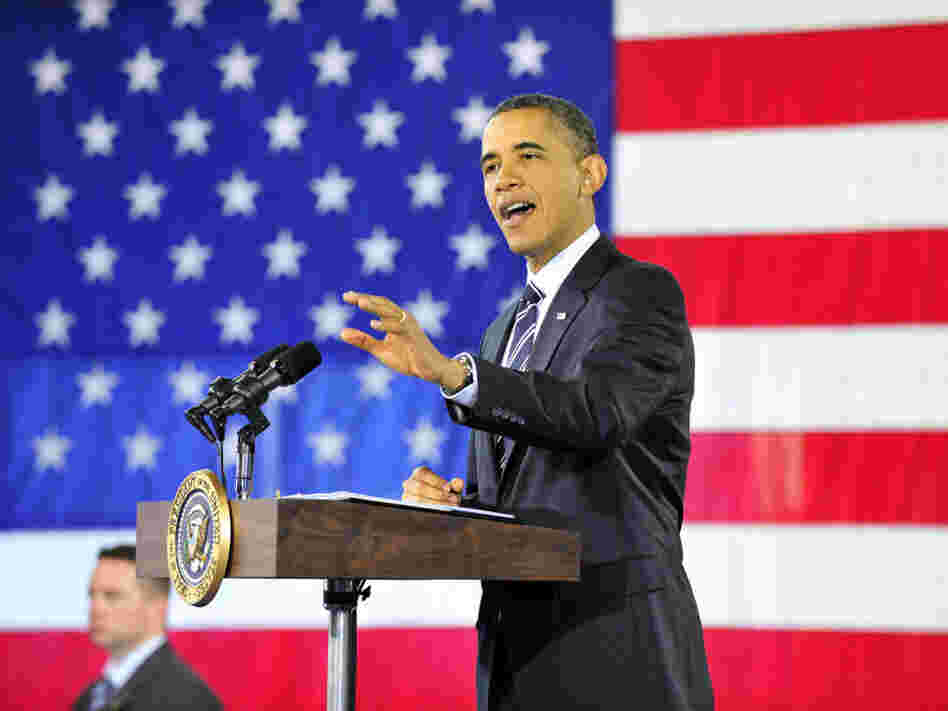 "President Obama speaks about the economy Friday in Arlington, Va. Obama says he wants to ""send a clear message to Congress: Do not slow down the recovery that we're on."""