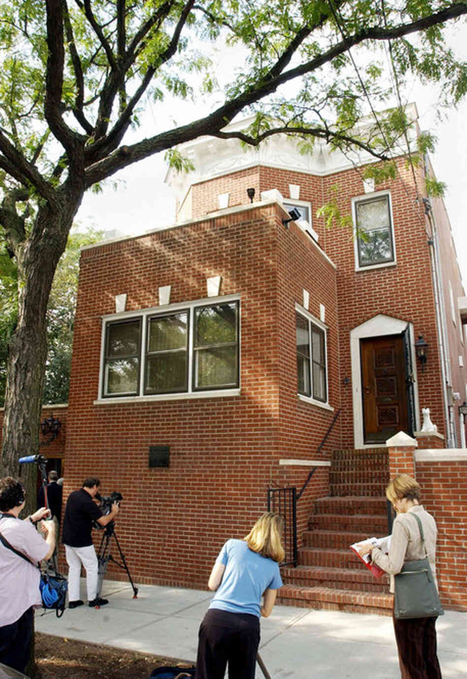New York City's landmarks board debated whether to offer historic status to jazz legend Louis Armstrong's Queens home because the red-brick residenc