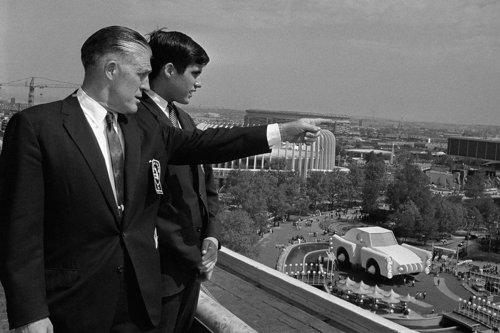 A young Romney looks over the New York World's Fair in 1964 with his father, then-Michican Gov. George Romney.