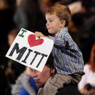 Tommy Sholeff, 3, holds a sign as he sits on his father's shoulders at the Nevada caucus victory celebration for Mitt Romney in Las Vegas Saturday.