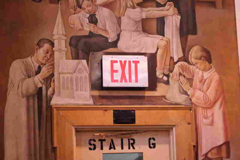 "Murals in the PS-150 auditorium depict scenes from the cultural and industrial arts. Pastor Jon Storck says public school gives the congregation a good position in the community – and other venues, even if nearby, spacious and affordable, wouldn't be as effective. ""We look at this as a place to minister,"" Storck says. ""It's a vital part of our mission."""