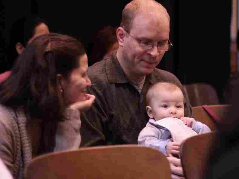 "Rob and Kasey Powers have been coming to Grace Fellowship for two years, and now are joined by their 6-month-old son, Simon. Initially, Rob said, he felt like he was back in elementary school. ""It was a little odd,"" he said, ""but this is New York City – you get used to stuff quickly."""