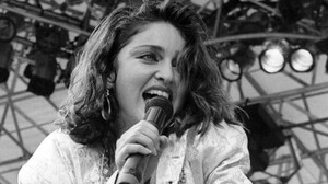 Madonna performs for a sold out crowd at the Live Aid concert at JFK Stadium in Philadelphia, Pennsylvania, July 13, 1985.
