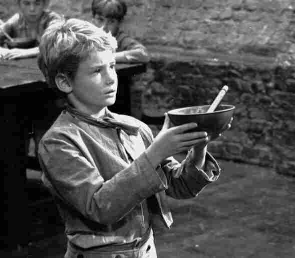 Poor orphan Oliver Twist was one of the 989 named characters Dickens created during his prolific career. Above, Mark Lester asks for more gruel during the 1967 filming of Oliver!