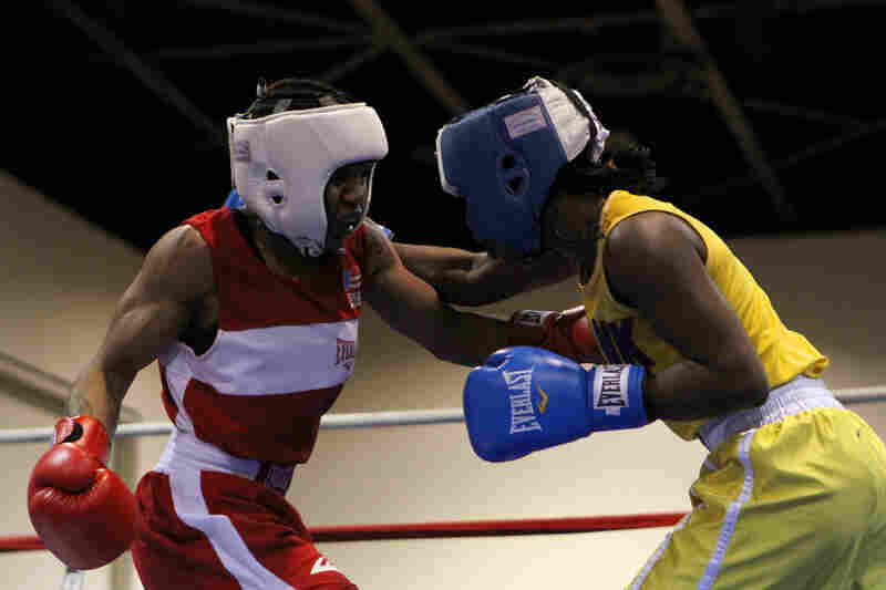 """""""I'm not only doing this for me, I'm doing this for the world,"""" says Douglas (left), shown here in a 2011 boxing tournament. """" 'Cause if I can do it, the next individual can do it. Just to see someone get that far in life, that's all I want to show, is that you can overcome anything and be anything you want in life — and I am gonna be that woman."""""""