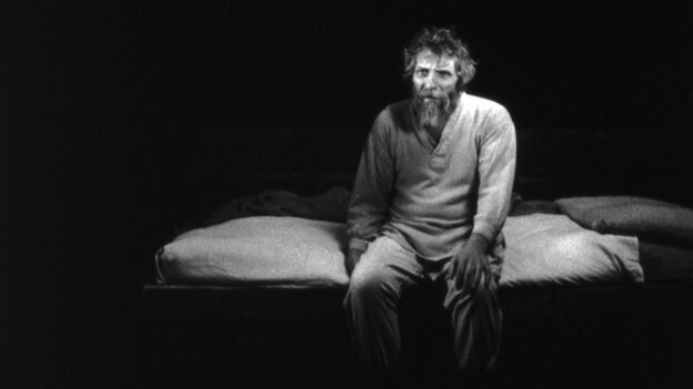 A rural farmer (Janos Derzsi) sits in the void-like darkness of his single-room farmhouse in The Turin Horse.