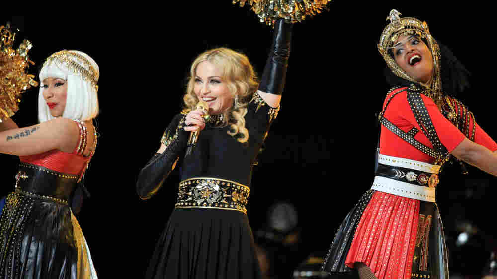 """Madonna (center), flanked by Nicki Minaj and M.I.A., during a performance of her new single """"Give Me All Your Luvin'"""" during the Bridgestone Super Bowl XLVI Halftime Show in Indianapolis."""