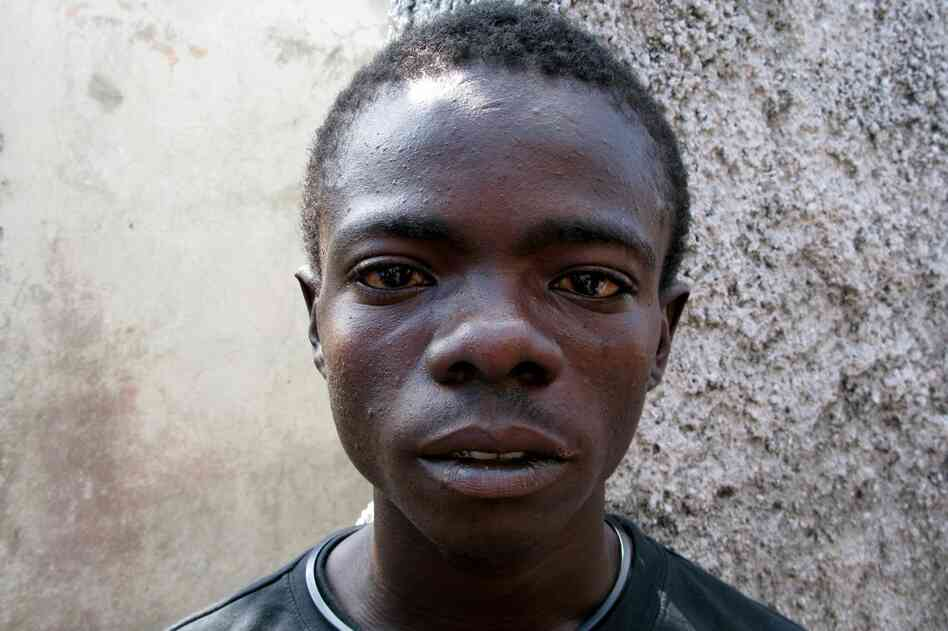 "Edison Charles, 19, contracted cholera early in 2011 and spent six days in a clinic. He says the disease is all over the Port-au-Prince slum of Cite Soleil: ""The cholera is like death; it's going from door to door."""