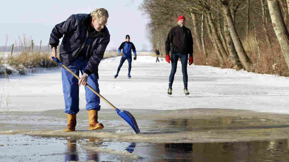 Volunteer Sjoerd Swart shovels away snow from the ice in Oudemirdum, Netherlands, in hopes the Elfstedentocht, or 11 Cities Tour, may be held for the first time in 15 years.