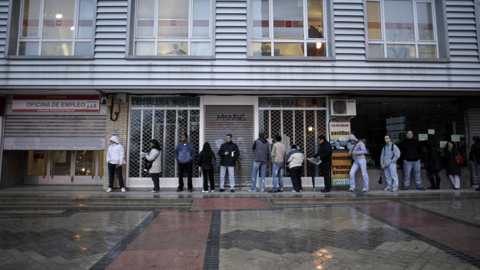 People queue outside an unemployment registry office in Madrid on Dec. 2. One in four Spaniards is out of work; about half of Spaniards in their 20s are jobless. (AP)