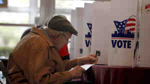 Charles Manley votes in Missouri's presidential primary on Tuesday in St. Louis.