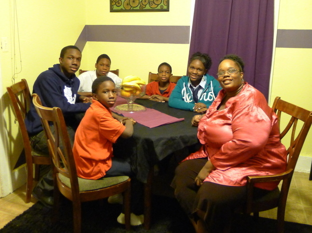 "Detroit Public Schools parent Myesha Williams (right) says her home's ""homework corner"" helps her kids focus."