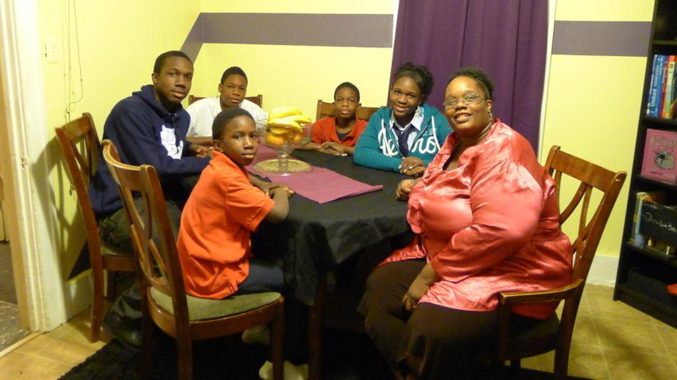 "Detroit Public Schools parent Myesha Williams (right) says her home's ""homework corner"" helps her kids focus."