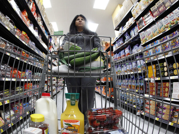 A shopper walks down an aisle in a newly opened Wal-Mart Neighborhood Market in Chicago.