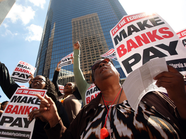 Anti-Wall Street demonstrators march on banks in Los Angeles in October.