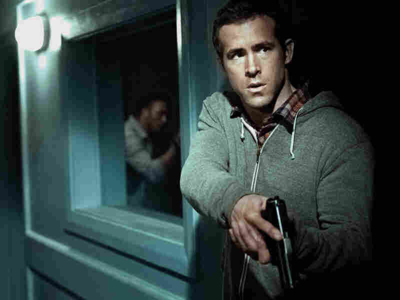 Inexperienced field agent Matt Weston (Ryan Reynolds) prepares to fend off an attack on his CIA safe house in Cape Town, South Africa.