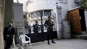 Egyptian soldiers stand guard in front of the U.S. National Democratic Institute, an NGO  rights group in downtown Cairo on December 29, 2011.