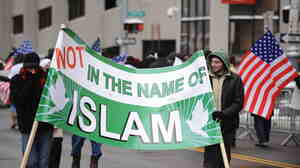 """January 2010: Muslim-Americans protest against terrorism outside a federal court building in Detroit, where """"Christmas Day"""" bomber Umar Farouk Abdulmutallab was being arraigned."""