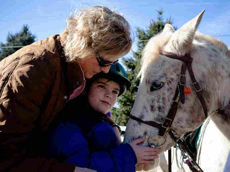 Cathy Coleman is a speech pathologist for the Northern Virginia Therapeutic Riding Program. She uses a horse named Happy in her therapy sessions with 9-year-old Ryan Shank-Rowe, who has autism.