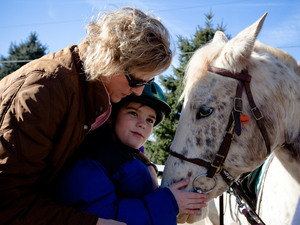 Cathy Coleman is a speech pathologist for the Northern Virginia Therapeutic Riding Program. She uses a horse named Happy in her therapy sessions with 9-year-old Ryan Rowe, who has autism.