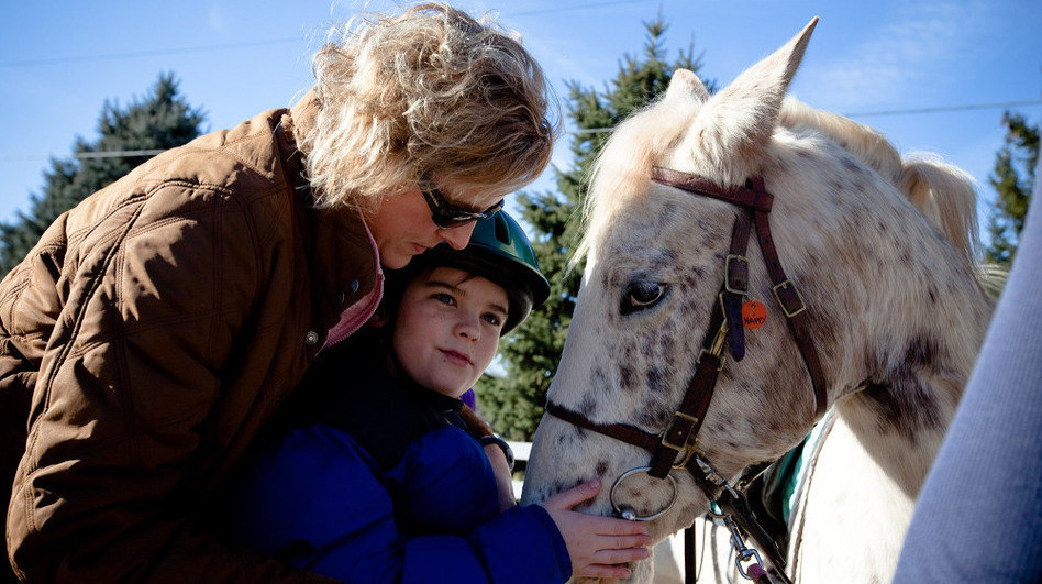 Cathy Coleman is a speech pathologist for the Northern Virginia Therapeutic Riding Program. She uses a horse named Happy in her therapy sessions with 9-year-old Ryan Shank-Rowe, who has autism. (NPR)