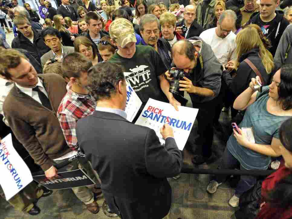GOP hopeful Rick Santorum, shown greeting supporters in Minnesota on Tuesday, drew votes in the Feb. 7 contests. But he didn't win any delegates.