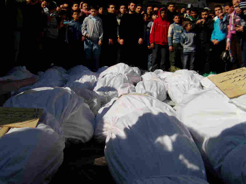 Residents attend a burial ceremony of what activists say are victims of shelling by the Syrian army in the Khalidiya neighborhood in Homs on Feb. 4.
