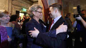 Gov. Chris Gregoire, left, embraces Rep. Jamie Pedersen, D-Seattle, after the Washington state House voted Wednesday to legalize gay marriage.