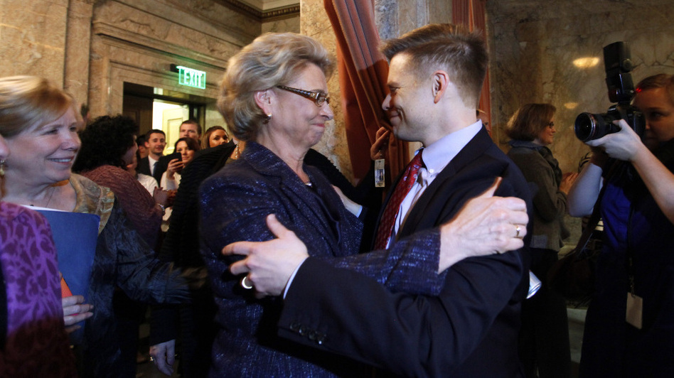Gov. Chris Gregoire, left, embraces Rep. Jamie Pedersen, D-Seattle, after the Washington state House voted Wednesday to legalize gay marriage. (AP)