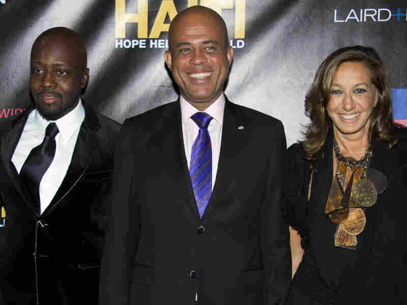 Donna Karan's work in post-earthquake Haiti inspires her designs. She is shown here with Wyclef Jean (left) and Haitian President Michel Martelly, attending a party to benefit Karan's Hope, Help and Rebuild Haiti charity.