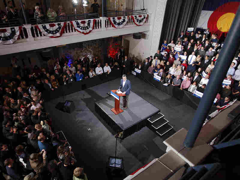 Republican presidential candidate Mitt Romney appears at a rally surrounded by supporters on Feb. 7, 2012 in Denver, Colorado. Santorum defeated Romney, Newt Gingrich and Ron Paul in the Missouri primary and Minnesota and Colorado caucuses.