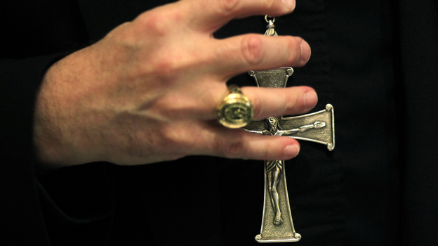 A bishop grasps his pectoral cross during the United States Conference of Catholic Bishops in Baltimore on Nov. 14, 2011.  (Reuters/Landov)