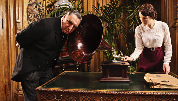 Listen Carefully: Some phrases have made it into Downton Abbey that are a little ahead of their time. Above, Mr. Carson (Jim Carter) tries out a newfangled gadget with Lady Mary (Michelle Dockery).
