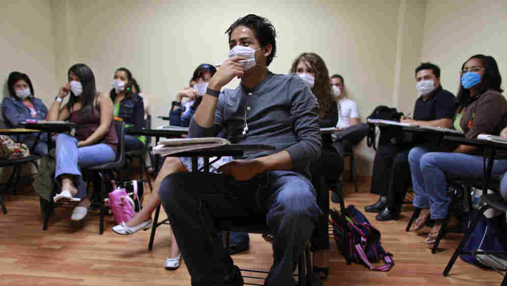 Students at a University of London class in Mexico City wear masks to protect them against swine flu in May 2009. High schools and universities closed by the pandemic had just reopened across Mexico.