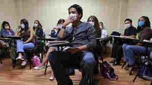 Students at a University of London class in Mexico City wear masks to protect them against swine flu in May 2009. High schools and universities closed by the pandemic had ju