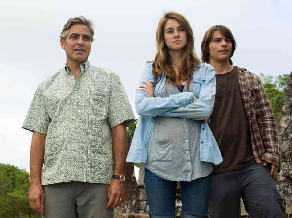 George Clooney as Matt King, Shailene Woodley as Alexandra King, and Nick Krause as Sid in The Descendants.