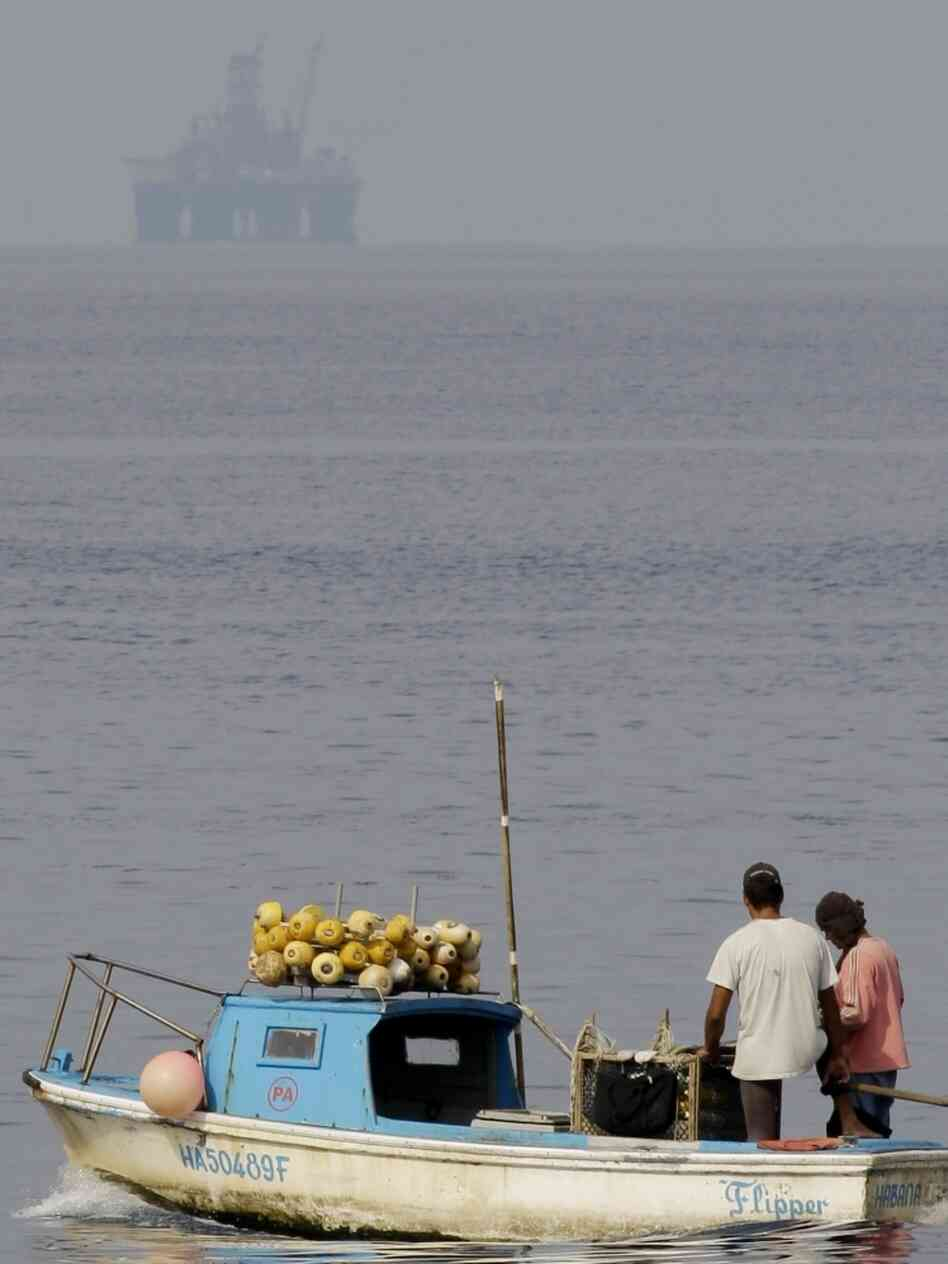 Fishermen work near the Scarabeo-9 oil rig off the coast of Cuba. U.S. officials are concerned about the potential impact in the case of a spill.