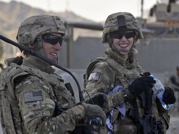 American soldiers Kris Kuntz (left) and Hayley Barner in Afghanistan, near the border with Pakistan, last October.