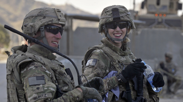 American soldiers Kris Kuntz (left) and Hayley Barner in Afghanistan, near the border with Pakistan, last October. (AFP/Getty Images)