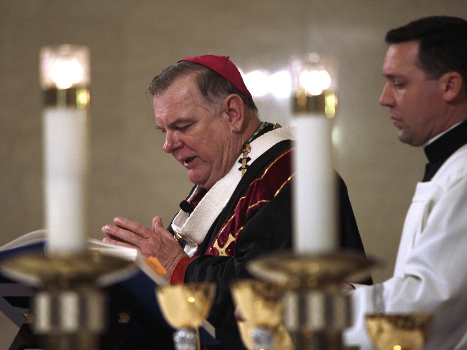 "Archbishop Thomas Wenski, shown celebrating Mass at the Cathedral of St. Mary in Miami last month, says the new birth control policy is a ""smoke screen."""