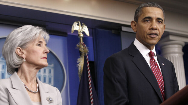 President Obama, flanked by Health and Human Services Secretary Kathleen Sebelius, announces the revamp of the contraception-care policy on Friday.