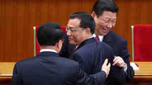 Chinese Vice President Xi Jinping (right) and Chinese Vice Premier Li Keqiang (center) chat with Li Changchun of the Chinese Communist Party's Central Committee after the party's 90th anniversary celebration in Beijing in July. Xi and Li Keqiang, members of a new generation of Chinese leaders, are expected to nab the top spots in an upcoming transition of power.