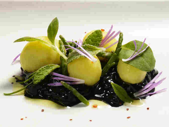 Steamed new harvest potatoes, cucumber, borage, and ice plant flower.