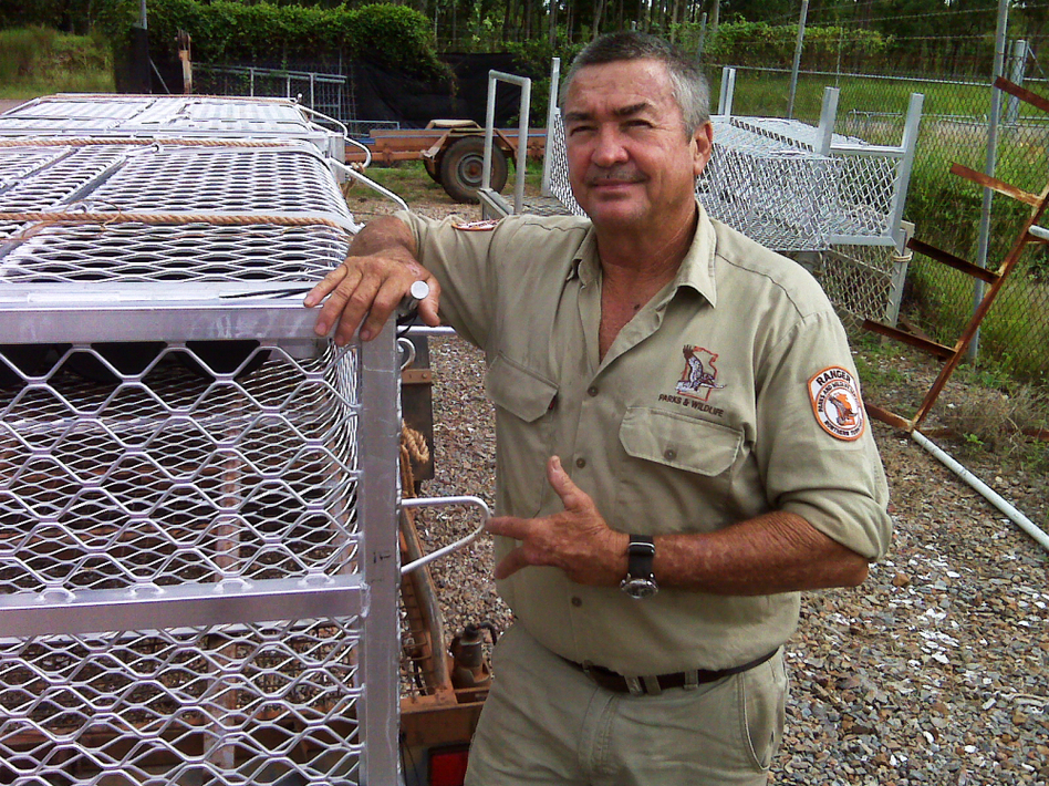 "Crocodile ranger Tom Nichols stands beside the crocodile traps used in Darwin Harbour. Nichols' left hand was mangled by an irate ""salty"" nine years ago. (John Burnett/NPR)"