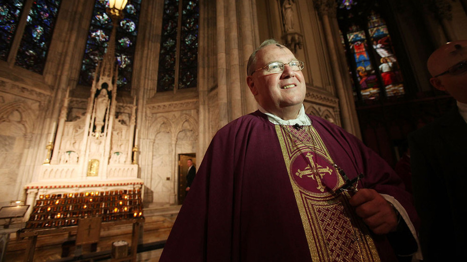 "Archbishop Timothy M. Dolan, head of the U.S. Conference of Catholic Bishops, shown at Ash Wednesday services at Saint Patrick's Cathedral last year, has called the Obama administration's decision ""a first step in the right direction."" (Getty Images)"