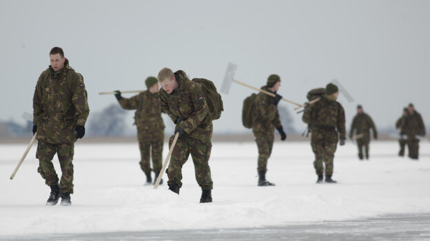 Dutch soldiers helped clear snow off lakes in hopes the Eleven Cities speedskating tour could go forward, but organizers cancelled the event because of unsafe ice.