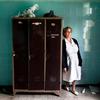 Nurse Stella Trivizaki stands in an abandoned locker room at Asklypeio Public Hospital in Athens, Greece.