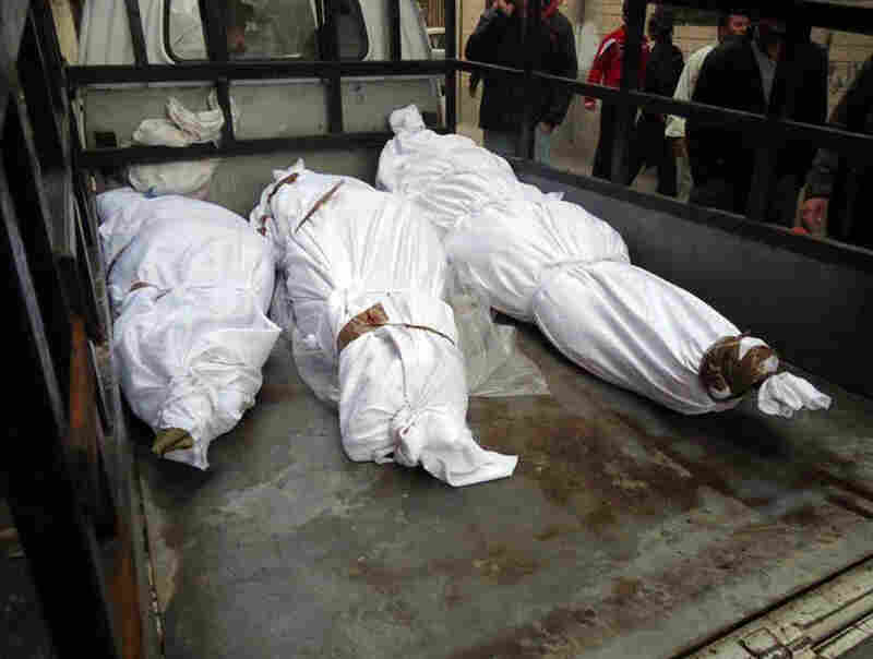 Bodies of what activists say are victims of shelling by the Syrian army in a Sunni Muslim district in the central city of Homs, on Feb. 8.